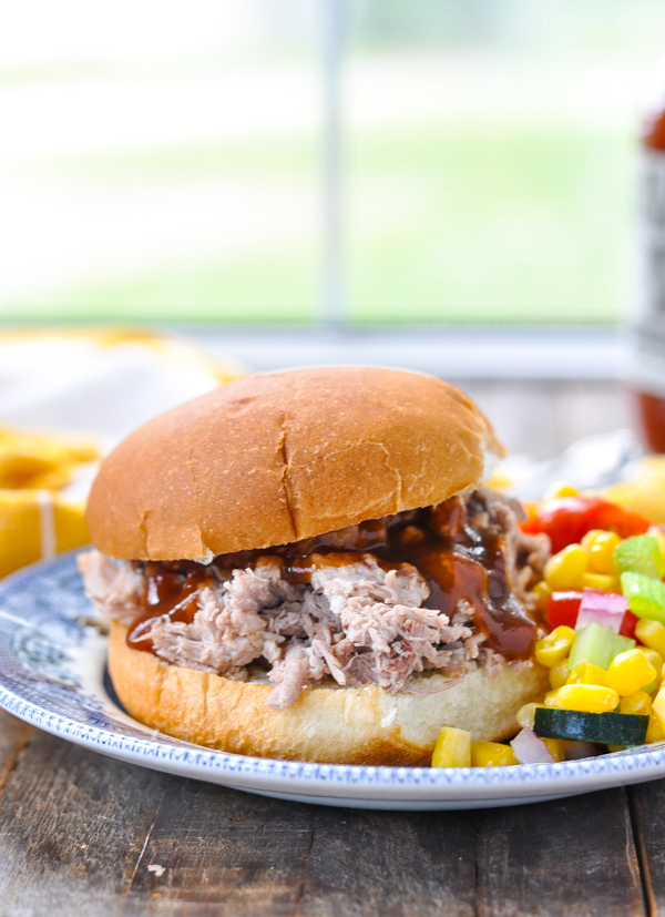 Slow cooker pulled pork on a sandwich bun with barbecue sauce