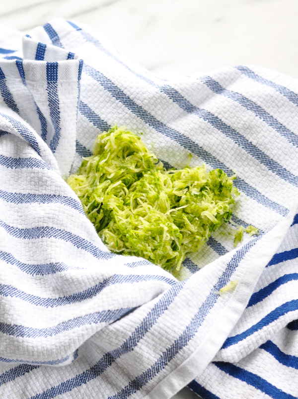 Grated zucchini in a dish towel