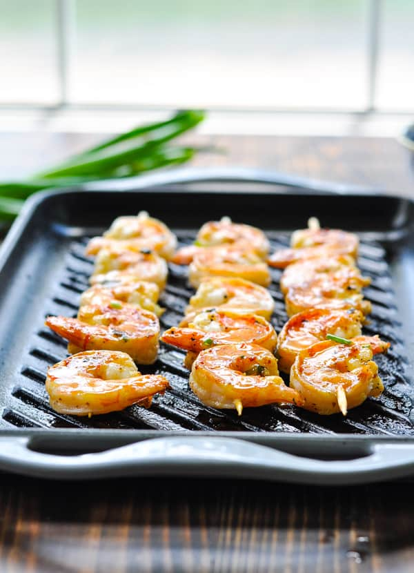 Front shot of shrimp skewers on a grill pan