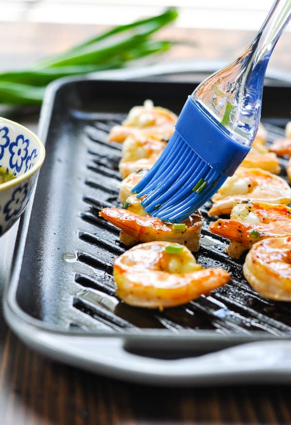 Brushing marinade on grilled shrimp