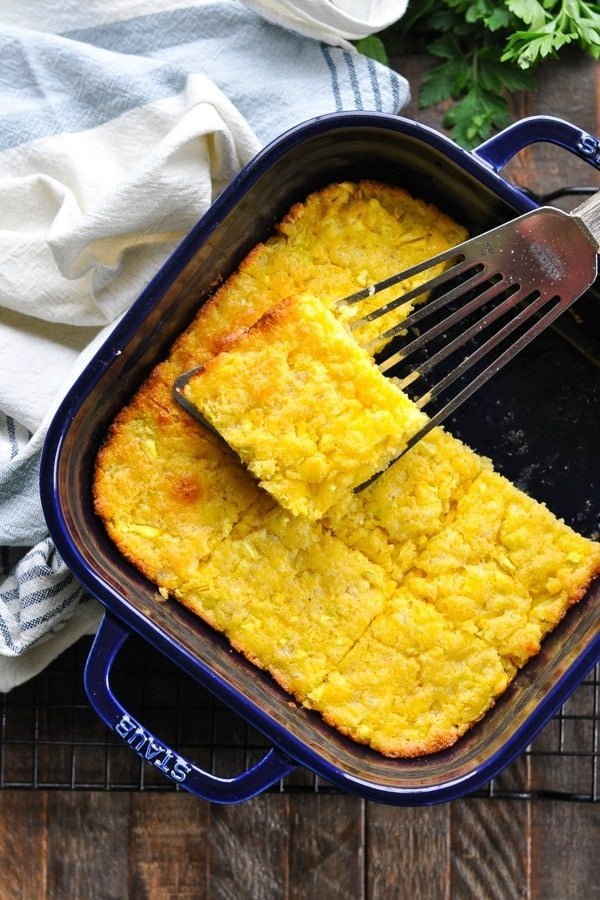 Overhead shot of cornbread in a blue baking dish