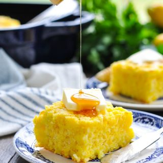 Drizzling honey over a piece of cornbread