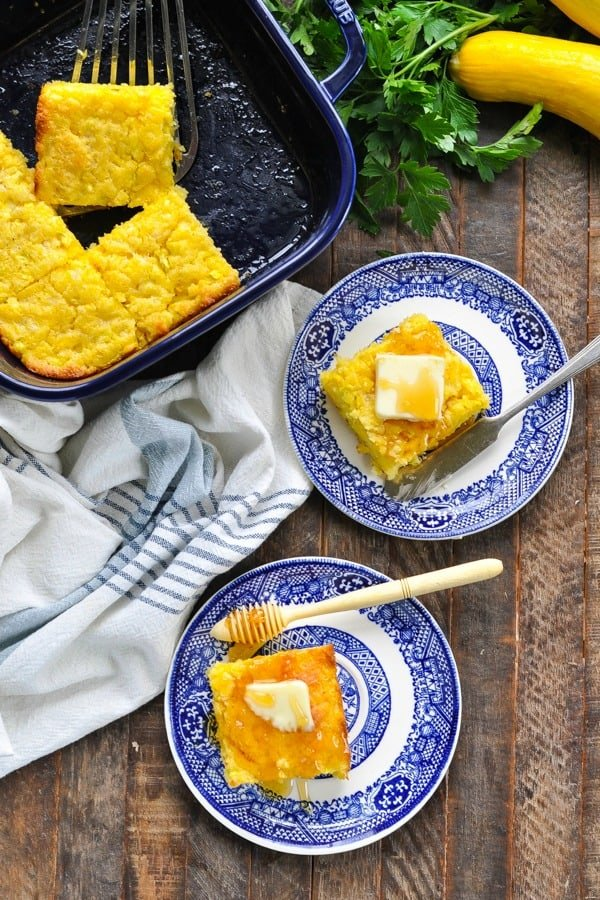 Long overhead shot of two pieces of cornbread on serving plates