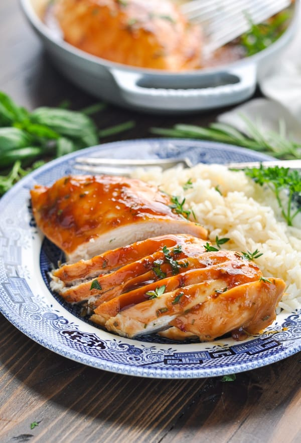 Sliced baked chicken breast on a dinner plate with rice