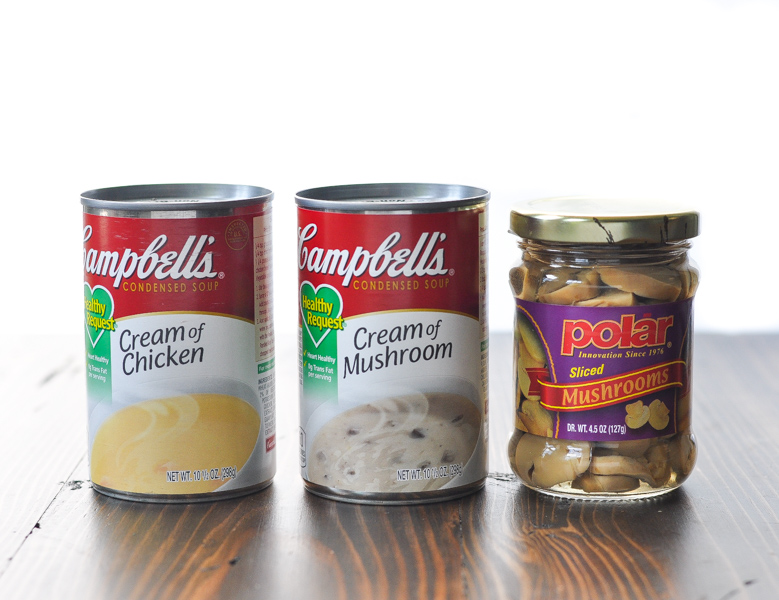 Cans of campbells soup and sliced mushrooms