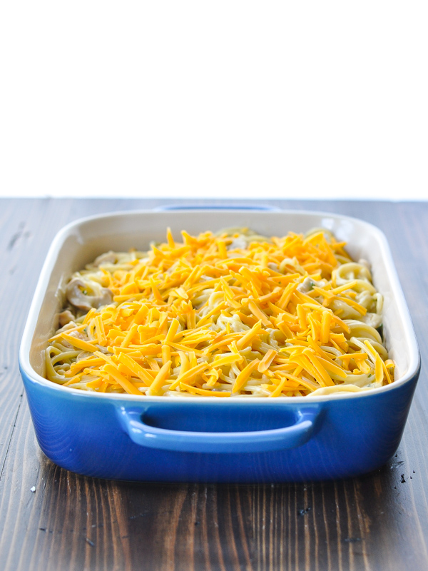 Chicken tetrazzini in a blue casserole dish before baking