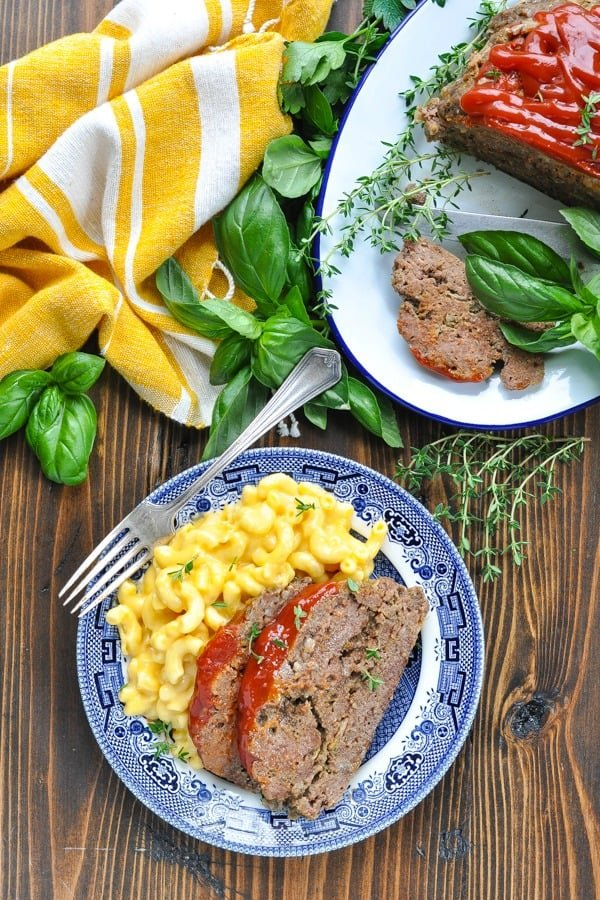 Long overhead shot of a plate of Crock Pot Meatloaf with mac and cheese