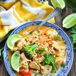 Close overhead shot of Thai chicken curry in a blue and white bowl served over rice