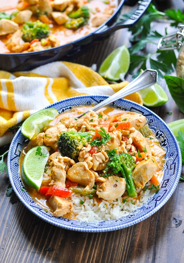 Front shot of Thai Chicken Coconut Curry with lime wedges