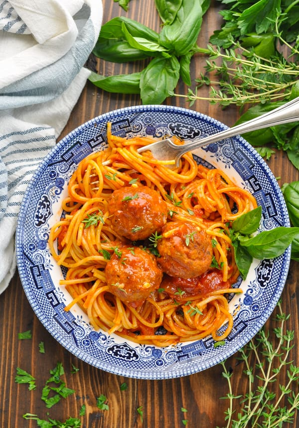 Overhead shot of pressure cooker spaghetti and meatballs in a blue and white bowl