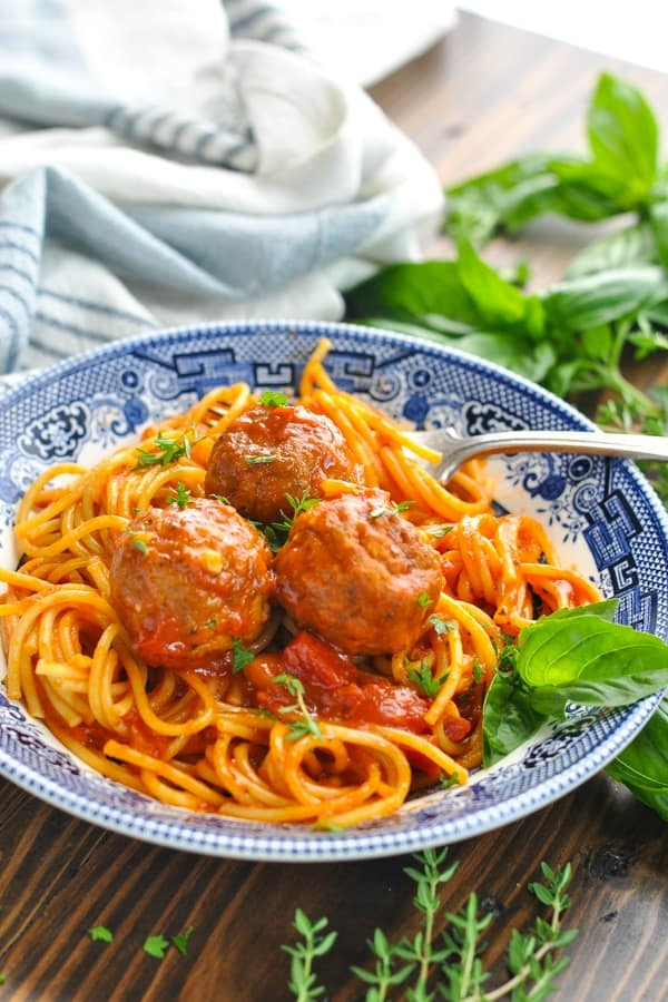Close front shot of Instant Pot Spaghetti and Meatballs in a blue and white bowl