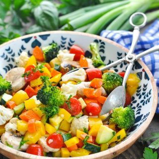 Front shot of marinated raw vegetables in a red wine vinaigrette salad dressing