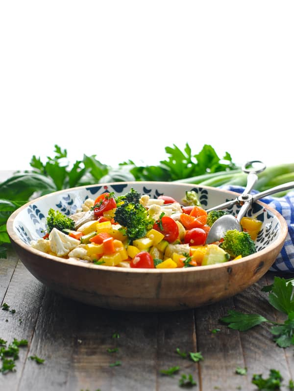 Front shot of fresh vegetable salad in a bowl on a table