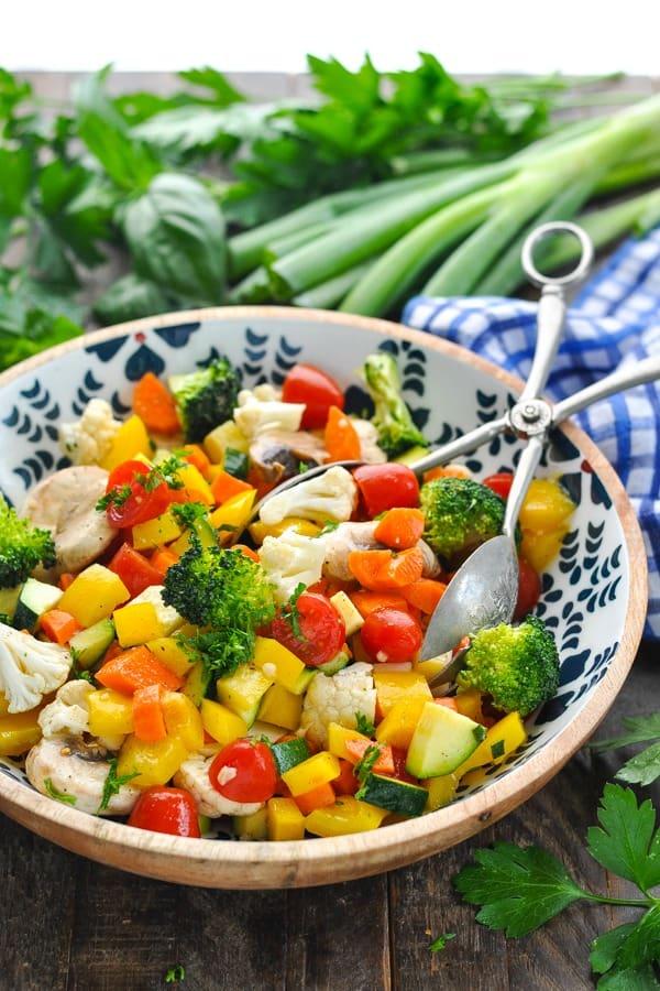Big serving bowl full of marinated vegetable salad