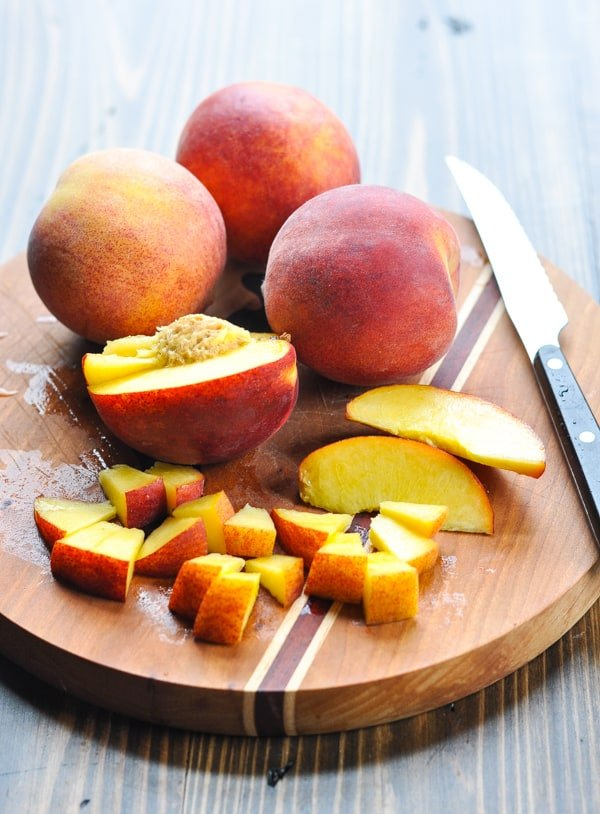 Diced peaches on a cutting board