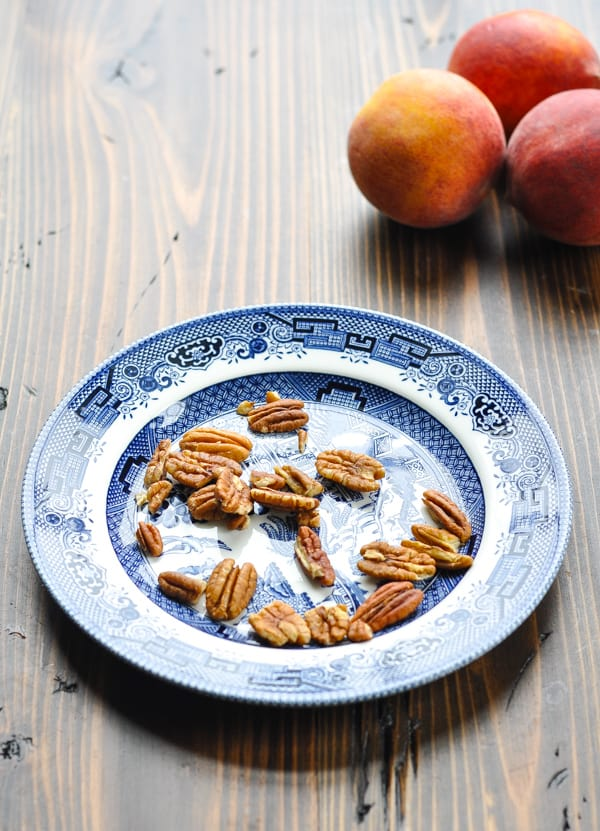 Toasted pecans on blue and white plate