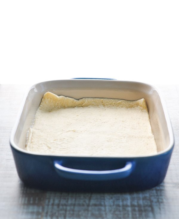Crescent roll dough in baking dish