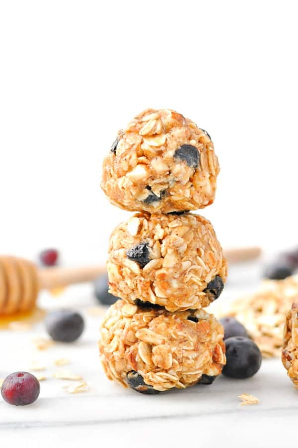 Stack of three no bake almond blueberry energy snacks