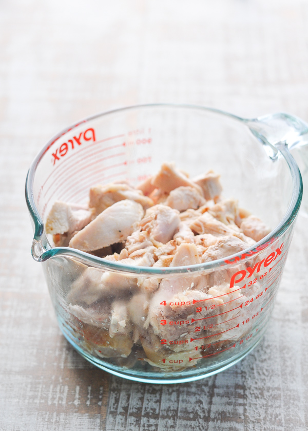 Cooked chicken in glass measuring cup