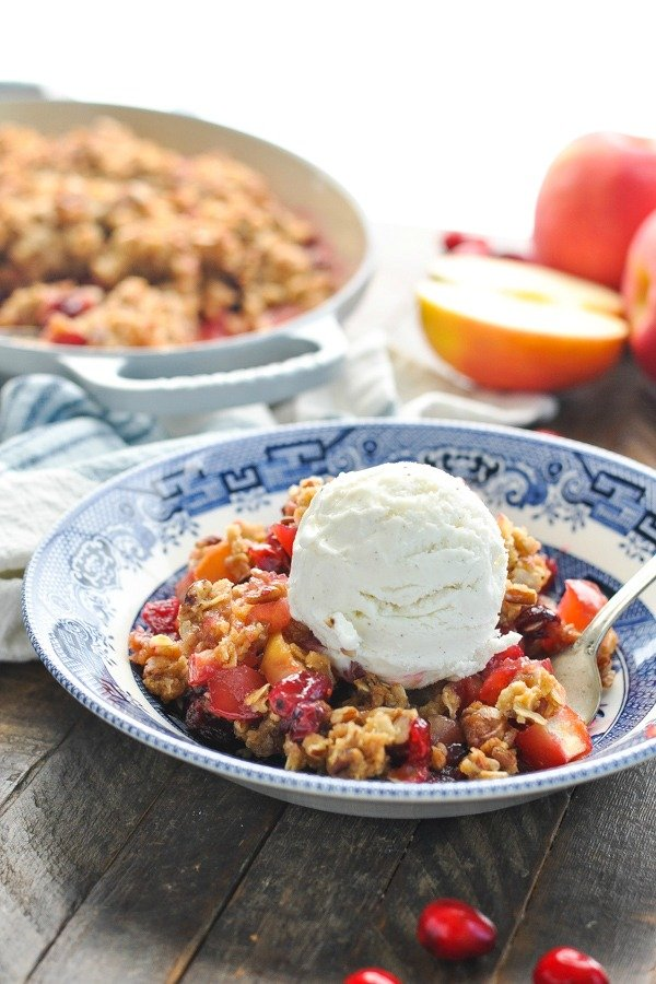 Easy apple crisp in a bowl with ice cream on top