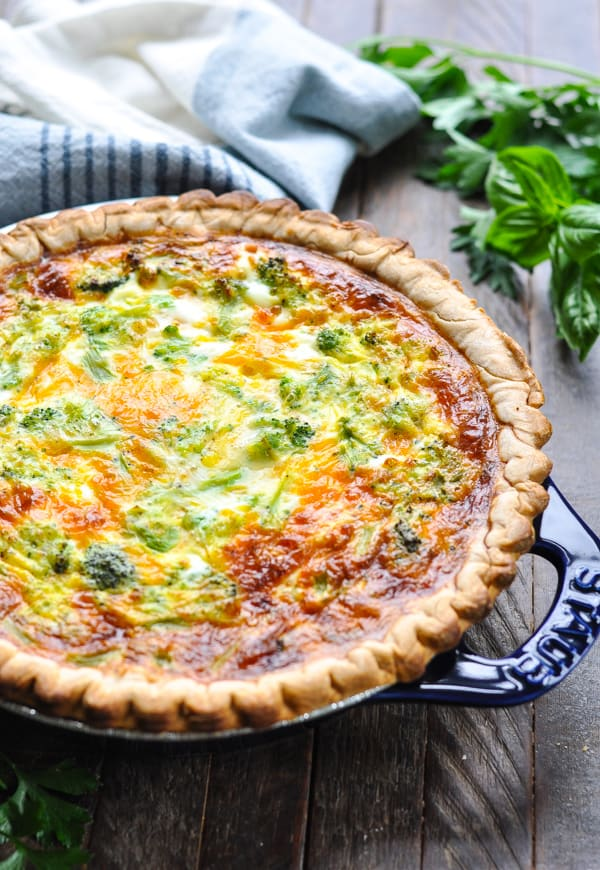 Baked broccoli quiche in blue pie plate