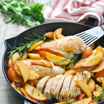 A skillet chicken recipe with apples and onions in the pan