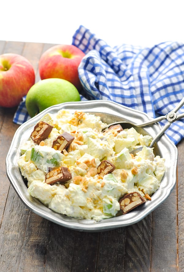 Front shot of Apple Salad with Snickers Bars in a silver serving bowl