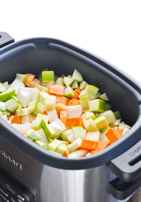 Raw vegetables for pork stew in slow cooker