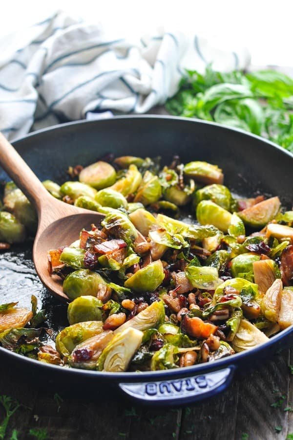 Front shot close up of Brussels Sprouts with bacon and cranberries in a skillet