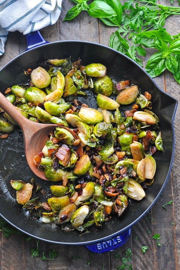 Overhead shot of roasted brussels sprouts with bacon in a skillet