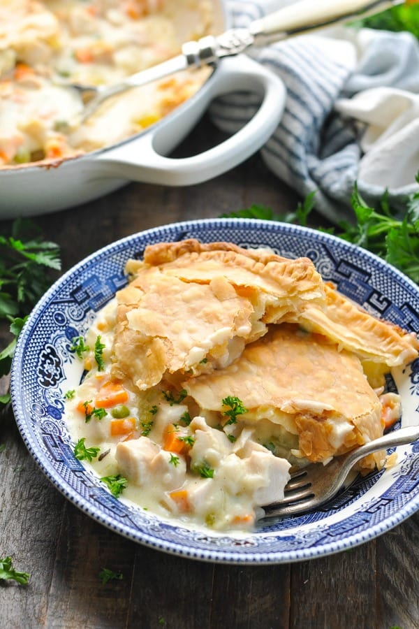 Close up shot of easy chicken pot pie in a blue and white bowl