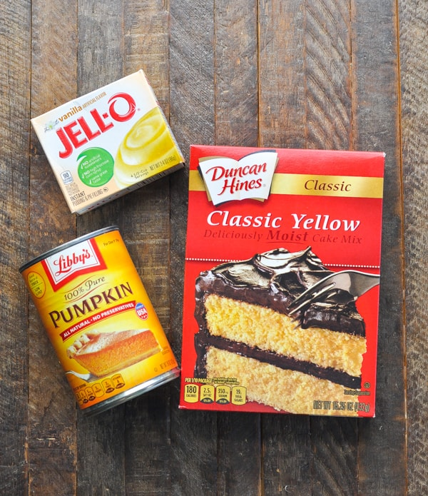 Box of yellow cake mix and can of pumpkin for pumpkin cake recipe