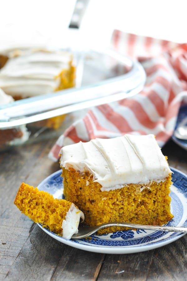 Side shot of pumpkin cake on a plate with bite on a fork