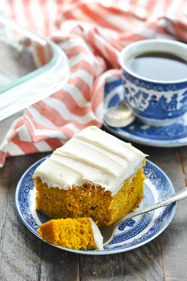 Front shot of easy pumpkin cake on a plate with coffee
