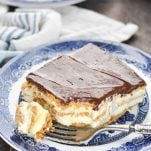 Long overhead shot of no bake eclair cake on a blue and white plate