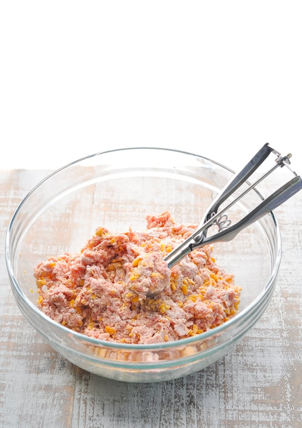 Sausage ball ingredients mixed together in a bowl