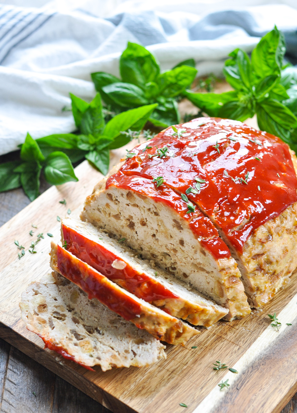 Front shot of sliced turkey meatloaf on a cutting board