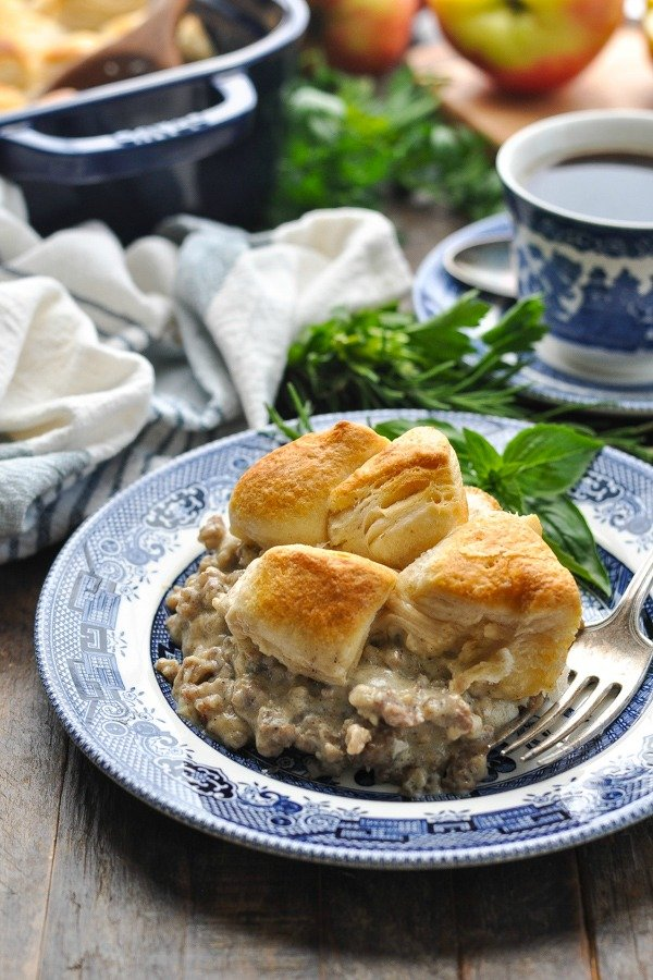 Front shot of biscuits and gravy casserole on a blue and white plate