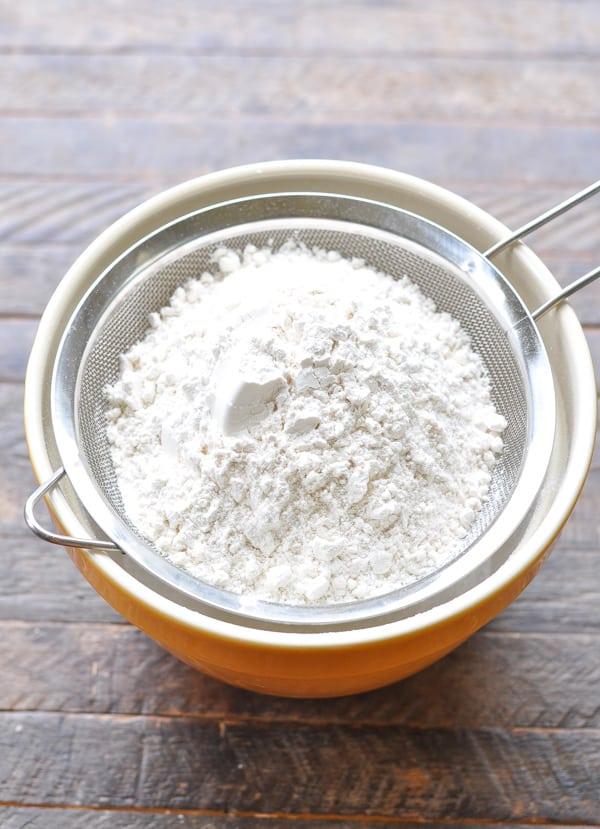 Sifting dry ingredients for blonde brownies