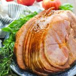 Front shot of Crock Pot Ham with Coke on a blue and white plate on a wooden surface
