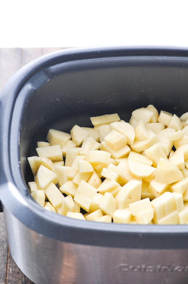 Chopped russet potatoes in a slow cooker