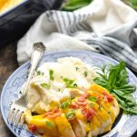 Crock Pot Ranch Chicken with Bacon and Cheese on a plate with mashed potatoes