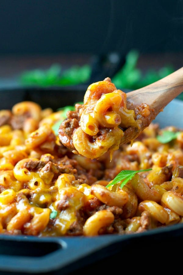 Wooden spoon scooping up homemade hamburger helper