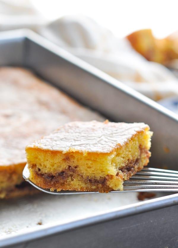 Piece of honey bun cake on a spatula