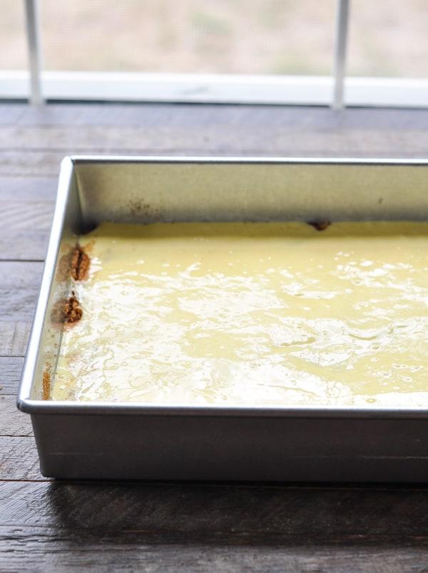 Final layer of batter on a honey bun cake