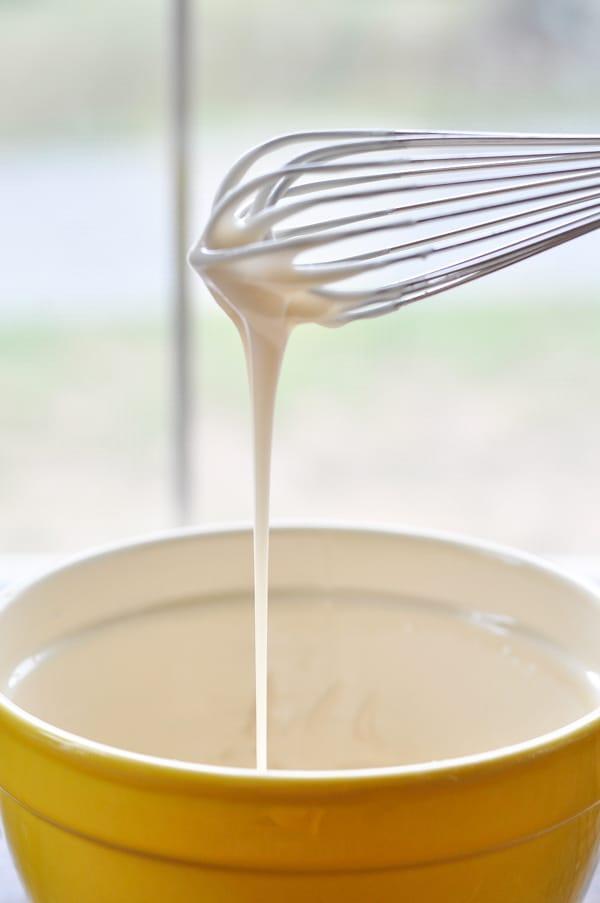 Whisk making glaze for honey bun cake