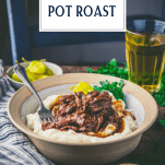 Side shot of mississippi pot roast on a dinner table with text title overlay