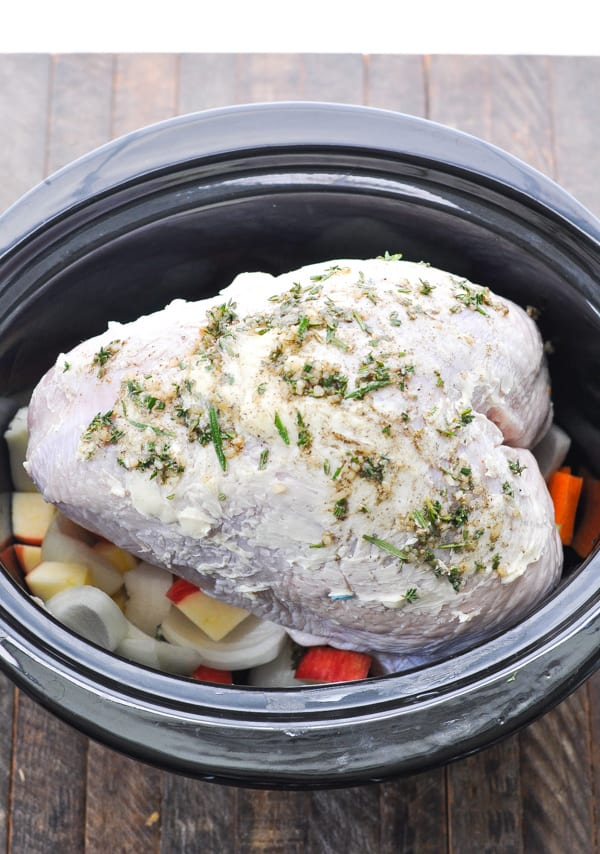 Turkey breast rubbed with butter and herbs and placed in slow cooker