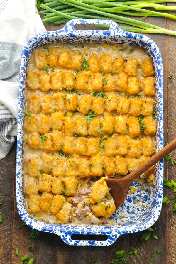 Overhead shot of Tater Tot Cowboy Casserole in a blue and white baking dish