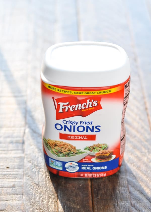 Can of French Fried Onions on a wooden surface